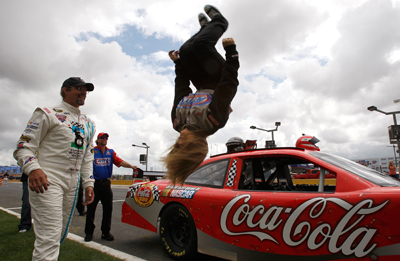 Shawn Johnson flips as Kyle Petty looks on at Lowe's Motor Speedway (credit: NASCAR)