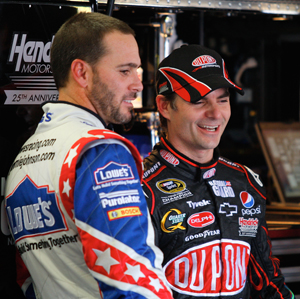 Jimmie Johnson, sporting a new haircut, jokes with Hendrick Motorsports teammate Jeff Gordon during practice for the Coca-Cola 600. Each driver has three wins in the historic race. (Photo Credit: Geoff Burke/Getty Images for NASCAR)