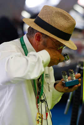 Team owner Jack Roush inspects spark plugs in the garage during practice for the Coca-Cola 600 at Lowe's Motor Speedway. (Photo Credit: Geoff Burke/Getty Images for NASCAR)