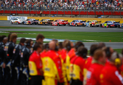 The Coca-Cola 600 was stopped just short of 3 p.m. ET to observe the National Moment of Remembrance. The cars lined up on the frontstretch and shut down the engines and crew members lined up the length of pit road to honor members of the military. (Photo Credit: Jason Smith/Getty Images)