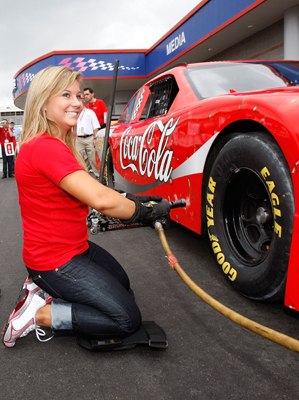 Olympic Gold Medalist and Dancing With the Stars winner Shawn Johnson learns how to change a tire before the Coca-Cola 600 at Lowe's Motor Speedway. (Photo Credit: Streeter Lecka/Getty Images for NASCAR)