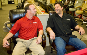Office Depot At The Speed of Smart sweepstakes winner Eddie Bell and NASCAR Sprint Cup driver Tony Stewart try out office chairs at a local Office Depot store in Charlotte, N.C.