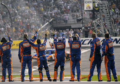 The crew members of Kyle Busch's No. 18 Joe Gibbs Racing Toyota celebrate winning the Lipton Tea 250 at Richmond International Raceway. (Photo Credit: Drew Hallowell/Getty Images)