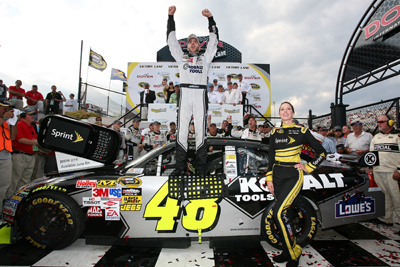 Jimmie Johnson celebrates his fourth win at Dover International Speedway and second win of the season in the NASCAR Sprint Cup Series Autism Speaks 400 Presented by Heluva Good! Sour Cream Dips and Cheese Sunday at Dover. (Photo Credit: Jerry Markland/Getty Images for NASCAR)