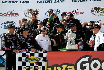 Brad Keselowski douses JR Motorsports owner Dale Earnhardt Jr. with champagne Saturday in Dover International Speedway's Victory Lane after winning the NASCAR Nationwide Series Heluva Good! 200. (Photo Credit: Jerry Markland/Getty Images for NASCAR)