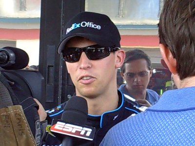 Denny Hamlin speaks with the media during his press conference outside his hauler at Infineon Raceway on Friday, June 19, 2009 (photo credit: The Fast and the Fabulous)