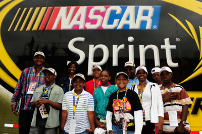 The group, Driven to Succeed, led by Tyrone McIntyre and Renee V. Wallace of Detroit Mich., attended the NASCAR Camping World Truck race on Saturday. As part of an ongoing effort to reach out to and engage the community, African American youth ages 7-17 from the local Detroit community spent a day at Michigan International Speedway learning about NASCAR and getting a behind-the-scenes look at what it takes to host a major race weekend. (Photo Credit: Rusty Jarrett/Getty Images for NASCAR)