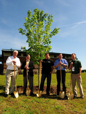 (Left to right) Rex Boner of The Conservation Fund, Mike Lynch, Managing Director of Green Innovation for NASCAR, Ryan Newman, Sprint Cup Series Driver, Roger Curtis, President of Michigan International Speedway and Kevin Sayers, Michigan State Coordinator of Urban and Community Forestry Program Kevin Sayers plant a tree for NASCAR's Tree-Planting Program To Capture Carbon Emissions prior to practice for the NASCAR Sprint Cup Series LifeLock 400 at Michigan International Speedway on Friday in Brooklyn, Mich. (Photo Credit: Rusty Jarrett/Getty Images for NASCAR)