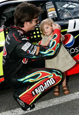 Jeff Gordon, driver of the No. 24 DuPont Chevrolet, gives daughter Ella Sophia earplugs on pit road just before the start of the NASCAR Sprint Cup Series Pocono 500 on Sunday at Pocono Raceway in Long Pond, Penn. (Photo Credit: Jason Smith/Getty Images)