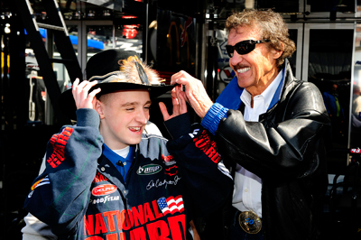 Richard Petty did the unthinkable for 13-year-old Thomas Harkins Jr. -- shared his famous hat. The New York City Spelling Bee champion met with Petty on Saturday morning in the garage at Pocono Raceway. (Photo Credit: Sam Greenwood/Getty Images)