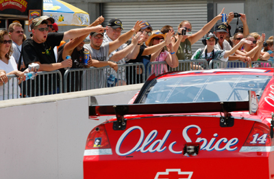 There's no doubt about the popularity of points leader and Indiana-native Tony Stewart, driver of the No. 14 Office Depot/Old Spice Chevrolet. Here the two-time winning driver gives fans a close-up as he heads through the garage for Friday's practice for the NASCAR Sprint Cup Series Allstate 400 at the Brickyard at Indianapolis Motor Speedway on Sunday. (Photo Credit: Geoff Burke/Getty Images for NASCAR)