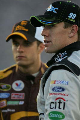 Teammates David Ragan (left), driver of the No. 6 UPS Ford, and Carl Edwards (right), driver of the No. 99 Aflac Ford, chat during Thursday's qualifying for the NASCAR Sprint Cup Series LifeLock.com 400 at Chicagoland Speedway on Saturday in Joliet, Ill. (Photo Credit: Todd Warshaw/Getty Images)