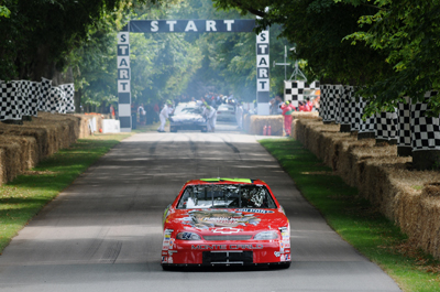 Driving the No. 24 Hendrick Motorsports T-Rex car, Landon Cassill takes on the hill climb Saturday at the Goodwood Festival of Speed in Chichester, England. (Photo Credit: Ed Heuvink)