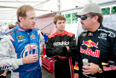 (Left to right) NASCAR Sprint Cup Series champion Rusty Wallace, Hendrick Motorsports driver Landon Cassill and NASCAR Camping World Truck Series driver Mike Skinner talk during The Goodwood Festival of Speed at The Goodwood Estate on Friday in Chichester, England. (Photo Credit: Peter Fox/Getty Images for NASCAR)