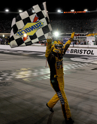 Kyle Busch celebrates winning the Sharpie 500, completing the season sweep at Bristol Motor Speedway. (Photo Credit: John Harrelson/Getty Images)
