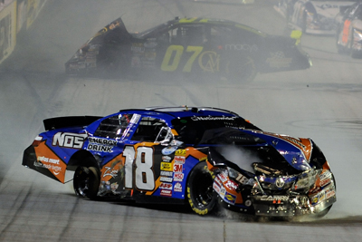 NASCAR Nationwide Series points leader Kyle Busch spins after making contact with Chase Austin on Lap 52. (Photo Credit: John Harrelson/Getty Images)