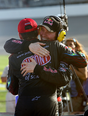 Race runner-up Jeff Gordon, driver of the No. 24 Dupont Chevrolet, congratulates Brian Vickers (right), driver of the No. 83 Red Bull Toyota, after the 25-year-old won Sunday's NASCAR Sprint Cup Series CARFAX 400 at Michigan International Speedway in Brooklyn, Mich. (Photo Credit: Jerry Markland/Getty Images for NASCAR)