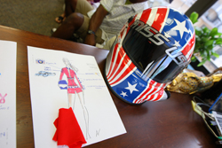 The design and helmet for 2009 Miss USA Kristen Dalton's NASCAR-themed costume for the Miss Universe Pageant are on display at Miss Universe Pageant Headquarters in New York City. (Photo Credit: Mike Stobe/Getty Images for NASCAR)