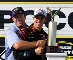 (Left to right) Joe Gibbs Racing President J.D. Gibbs congratulates Denny Hamlin, driver of the No. 11 FedEx Express Toyota, on Monday after Hamlin's fifth career NASCAR Sprint Cup Series win in the Sunoco Red Cross Pennsylvania 500 and third at Pocono Raceway in Long Pond, Pa. (Photo Credit: Chris Trotman/Getty Images for NASCAR)