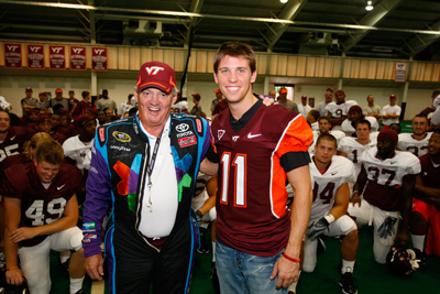 (Left to right) Virginia Tech football coach Frank Beamer and NASCAR Sprint Cup Series driver Denny Hamlin switch uniforms Thursday in Blacksburg, Va. during Hamlin's visit to promote next month's race weekend at Richmond International Raceway. (Photo Credit: Harrelson Photography / Richmond International Raceway)