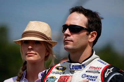 Jimmie Johnson, driver of the No. 48 Lowe's Chevrolet, stands with his wife Chandra on the grid prior to the NASCAR Sprint Cup Series Heluva Good! Sour Cream Dips at Watkins Glen International on Monday in Watkins Glen, N.Y. (Photo Credit: Chris Graythen/Getty Images)