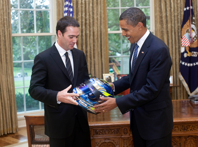 (Left to right) Three-time defending NASCAR Sprint Cup Series champion Jimmie Johnson presents President Barack Obama with a helmet in the Oval Office at the White House in Washington, D.C. on Wednesday. (Photo Credit: Official White House Photo)
