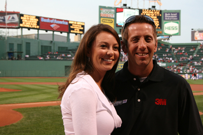 Defending SYLVANIA 300 winner, Greg Biffle, and his wife, Nicole, grab a picture prior to the Red Sox pre-game activities at Fenway Park in Boston on Tuesday, Sept. 8. (Photo Credit: NHMS)