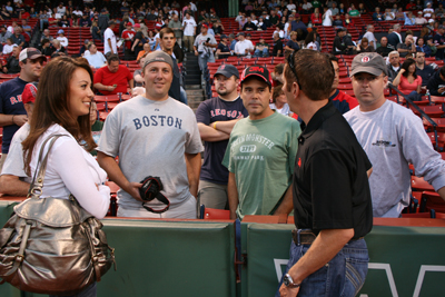 Greg and Nicole chat with some NASCAR fans on the field prior to the Red Sox game in Boston on Tuesday, Sept. 8. (Photo Credit: NHMS)