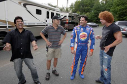 Tony Stewart, driver/owner at Stewart-Haas Racing, pictured in center in his BURGER KING fire suit, shares some laughs with actor, Erik Estrada (left) and comedian/actor, Carrot Top (right), during a break behind the scenes of Burger King Corp.s ad shoot, The Tony Stewart School of Endorsements.