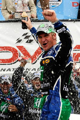 Clint Bowyer celebrates winning the Dover 200 at Dover International Speedway, his second win of the season. (Photo Credit: Jeff Zelevansky/Getty Images)