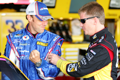 Former Roush Fenway Racing teammates Jeff Burton and Matt Kenseth joke around in the garage before practice for the AAA 400 at Dover International Speedway. (Photo Credit: Todd Warshaw/Getty Images for NASCAR)