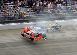 Joey Logano was involved in a spectacular accident going into Turn 3 on Lap 31 of the AAA 400 at Dover International Speedway. Logano rolled his car several times, but walked away from the accident with no injuries. (Photo Credit: Jerry Markland/Getty Images for NASCAR)