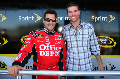 (Left to right) Tony Stewart, driver of the No. 14 Old Spice/Office Depot Chevrolet, poses with country music singer Josh Turner, prior to the start of the NASCAR Sprint Cup Series Sylvania 300 at the New Hampshire Motor Speedway on Sunday in Loudon, N.H. (Photo Credit: Jason Smith/Getty Images for NASCAR)
