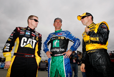 Jeff Burton, driver of the No. 31 Caterpillar Chevrolet, Clint Bowyer, driver of the No. 33 Holiday Inn Chevrolet, and Matt Kenseth, driver of the No. 17 Dewalt Ford, talk in the garage area during Friday's practice for the NASCAR Sprint Cup Series Chevy Rock & Roll 400 at Richmond International Raceway in Richmond, Va. (Photo Credit: Streeter Lecka/Getty Images)