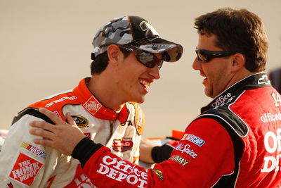 Joey Logano, driver of the No. 20 Home Depot Toyota, shares a laugh on pit road with Tony Stewart, driver of the No. 14 Office Depot Chevrolet, during qualifying on Friday for Saturday's NASCAR Sprint Cup Series Chevy Rock & Roll 400 at Richmond International Raceway. (Photo Credit: Chris Graythen/Getty Images)