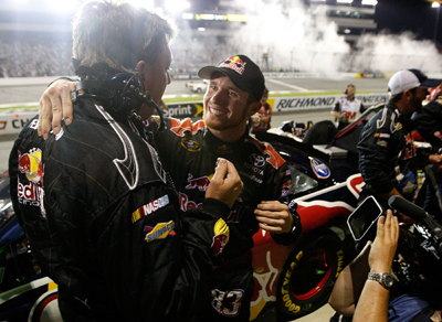 Brian Vickers is congratulated by crew chief Ryan Pemberton after racing his way into the Chase for the NASCAR Sprint Cup. (Photo Credit: Streeter Lecka/Getty Images)