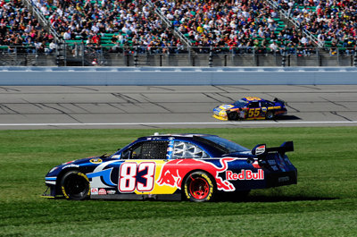 Chase for the Sprint Cup first-time contender Brian Vickers, driver of the No. 83 Red Bull Toyota, spun out in the infield grass in Turn 4 to bring out the caution on lap 149 during Sunday's NASCAR Sprint Cup Series Price Chopper 400 presented by Kraft Foods at the Kansas Speedway. It wasn't a good day for Vickers, who ended up finishing in 37th after having engine problems. (Photo Credit: Rusty Jarrett/Getty Images for NASCAR)
