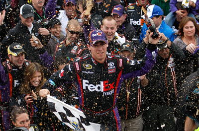 Denny Hamlin celebrates winning the TUMS Fast Relief 500 at Martinsville Speedway, his second career win at the Virginia short track. (Photo Credit: Geoff Burke/Getty Images for NASCAR)