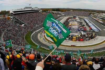 Fans wave green flags to start the TUMS Fast Relief 500 at Martinsville Speedway. The fans served as the Grand Marshals and Honorary Starters for the race. (Photo Credit: Jason Smith/Getty Images for NASCAR)