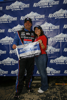 Mike Skinner poses with wife Angie after winning the pole for the Kroger 200 at Martinsville Speedway, his NASCAR Camping World Truck Series leading 50th career pole. (Photo Credit: Jason Smith/Getty Images for NASCAR)