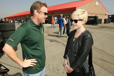 (Right to left) Dancing With The Stars competitor Kelly Osbourne meets NASCAR Nationwide Series driver Kenny Wallace before the Copart 300 Saturday at Auto Club Speedway in Fontana, Calif. Osbourne was the honorary starter for Saturday's NASCAR Nationwide Series Copart 300. (Photo Credit: Stephen Dunn/Getty Images for NASCAR)
