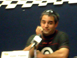 Juan Pablo Montoya answers the media's questions on Friday, October 9, 2009 at Auto Club Speedway in Fontana, CA (photo credit: The Fast and the Fabulous)