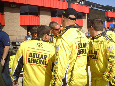 The No. 32 Dollar General pit crew get pumped up before the start of the Copart 300 on Saturday, October 10, 2009 at Auto Club Speedway in Fontana, CA (photo credit: The Fast and the Fabulous)