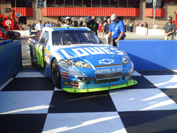 Jimmie Johnson, driver of the No. 48 Lowe's Chevrolet, pulls into Victory Lane on Sunday, October 11, 2009 at Auto Club Speedway in Fontana, CA (photo credit: The Fast and the Fabulous)