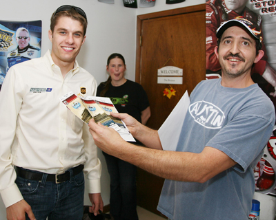 Longtime season ticket holder Mike Bruno Jr., right, poses with his tickets to Feb. 14's NASCAR Sprint Cup Series Daytona 500 and driver of the No. 6 UPS Ford, David Ragan on Tuesday as Ragan hand-delivered him tickets for NASCAR Sprint Cup Series Daytona 500 on Feb. 14, 2010. (Photo Credit: Jerry Markland/Daytona International Speedway)
