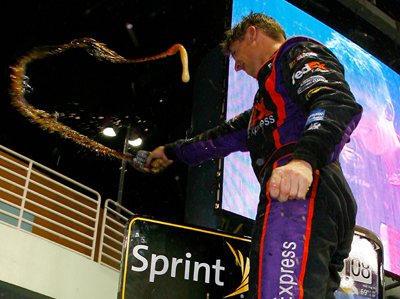 Denny Hamlin celebrates winning the Ford 400 at Homestead-Miami Speedway, his fourth victory of the season. (Photo Credit: Jason Smith/Getty Images for NASCAR)