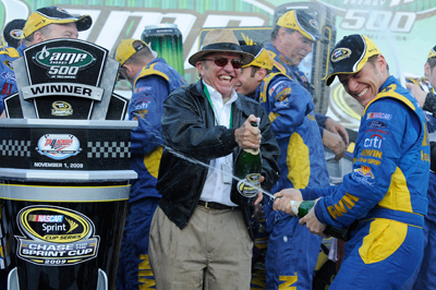 (Center to right) Team owner Jack Roush and Jamie McMurray, driver of the No. 26 IRWIN Marathon Ford, celebrate in McMurray's third career win in Victory Lane after winning the NASCAR Sprint Cup Series AMP Energy 500 at Talladega Superspeedway on Sunday in Talladega, Ala. (Photo Credit: John Harrelson/Getty Images for NASCAR)