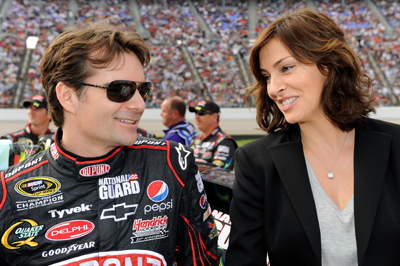 Jeff Gordon, driver of the No. 24 DuPont Chevrolet, stands on pit road with his wife Ingrid Vandebosch before the start of the NASCAR Sprint Cup Series Dickies 500 at Texas Motor Speedway on Sunday in Fort Worth, Texas. (Photo Credit: Rusty Jarrett/Getty Images for NASCAR)