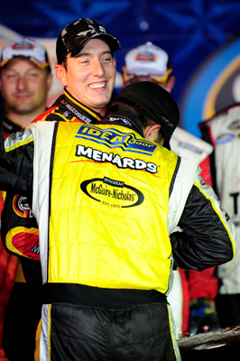 Matt Crafton, driver of the No. 88 Menards/McGuire-Nicolas Chevrolet, hugs race winner Kyle Busch, driver of the No. 51 Miccosukee Resort/Graceway Toyota,in Victory Lane after Busch beat the pole sitter to the checkered flag in Friday's NASCAR Camping World Truck Series WinStar World Casino 350 at Texas Motor Speedway in Fort Worth, Texas. (Photo Credit: Rusty Jarrett/Getty Images for NASCAR)