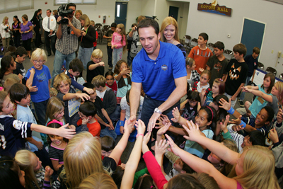 Four-time NASCAR Sprint Cup Champion Jimmie Johnson, driver of the No. 48 Lowe's Chevrolet, and his wife Chandra meet with students at his alma mater, Crest Elementary School on Monday in El Cajon, Calif. (Photo Credit: Todd Warshaw/Getty Images for NASCAR)